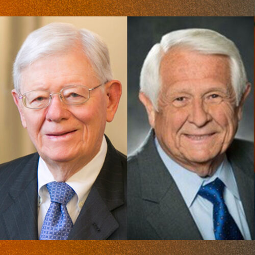 Headshots of four men wearing business suits