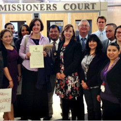 Clinical Professors Ariel Dulitzky and Jeana Lungwitz with their students at the Travis County Commissioners Court on April 8, 2014 after the resolution was passed making freedom from domestic violence a human right in Travis County, Texas.