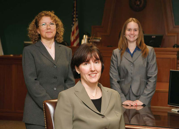 Clinical professors Sarah Buel and Jeana Lungwitz, together with Lisa Snead, '09, at the Travis County Courthouse. Photo Credit: Mark Rutkowski