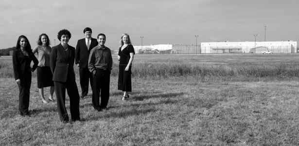 Farheen Jan, '08, Elise Harriger, '08, Immigration Clinic Director and Clinical Professor Barbara Hines, Matt Pizzo, '08, Clinic Administrator Eduardo Maraboto, and Kate Lincoln-Goldfinch, '08, outside the Hutto facility in Taylor, Texas.