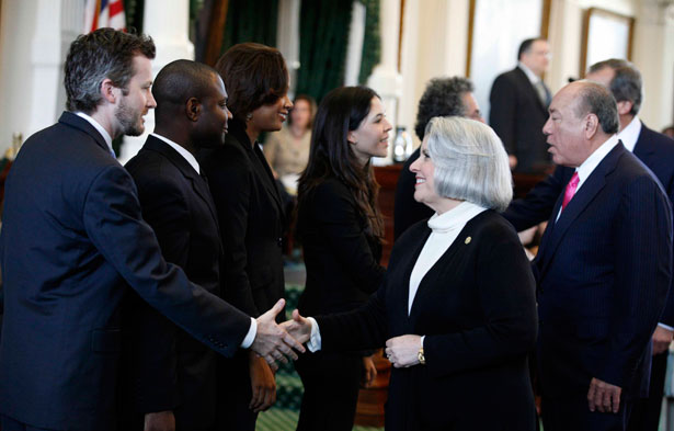Internship students shake hands with Senator Judith Zaffirini on Texas Senate floor.