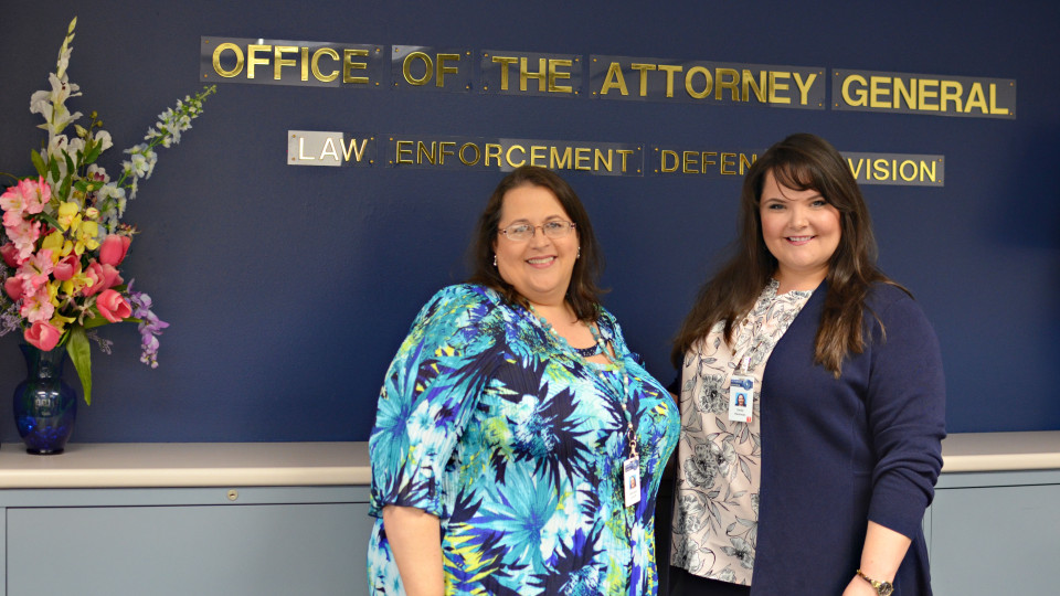 Emily Hammon and her supervisor at the Attorney General's office