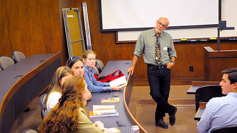 A Texas Law faculty member teaching class