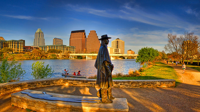 Statue of guitarist Stevie Ray Vaughan on the shore of Town Lake