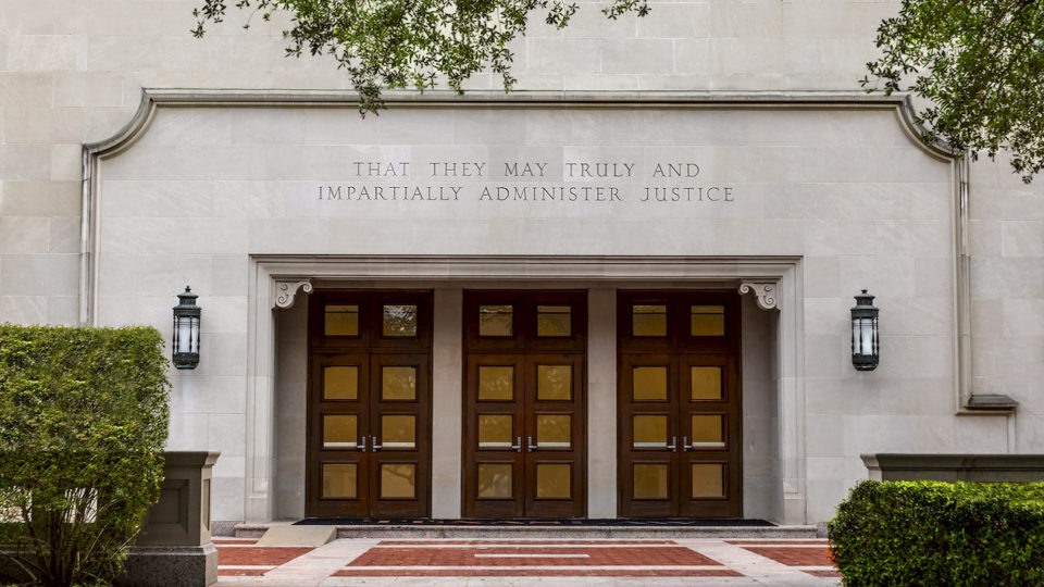 "Entrance to Townes Hall. Above the door an inscription: ""That they may truly and impartially administer justice."""
