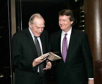 Bill Powers presents B Rapoport with a rare book of poetry, 2005. Courtesy of Dave Mayfield.