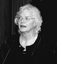 Molly Ivins speaking at the dinner honoring B and Audre Rapoport, 2005. Courtesy of Dave Mayfield.