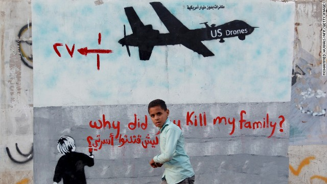 young man standing next to wall about US drones