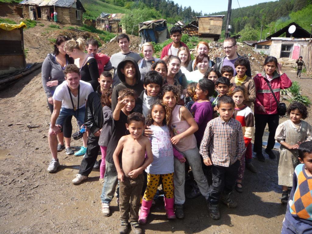 Romani children pose for a photograph