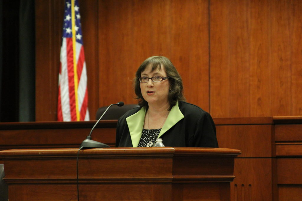 Julia Gordon, speaking in the Eidman Courtroom