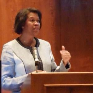 Michele Dickerson at podium