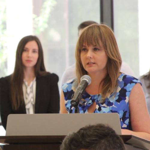 Photo of Andrea Marsh speaking at podium