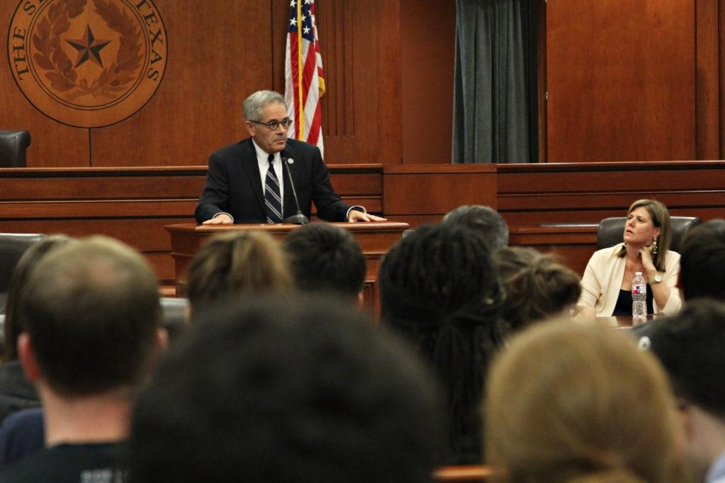Larry Krasner speaking at podium