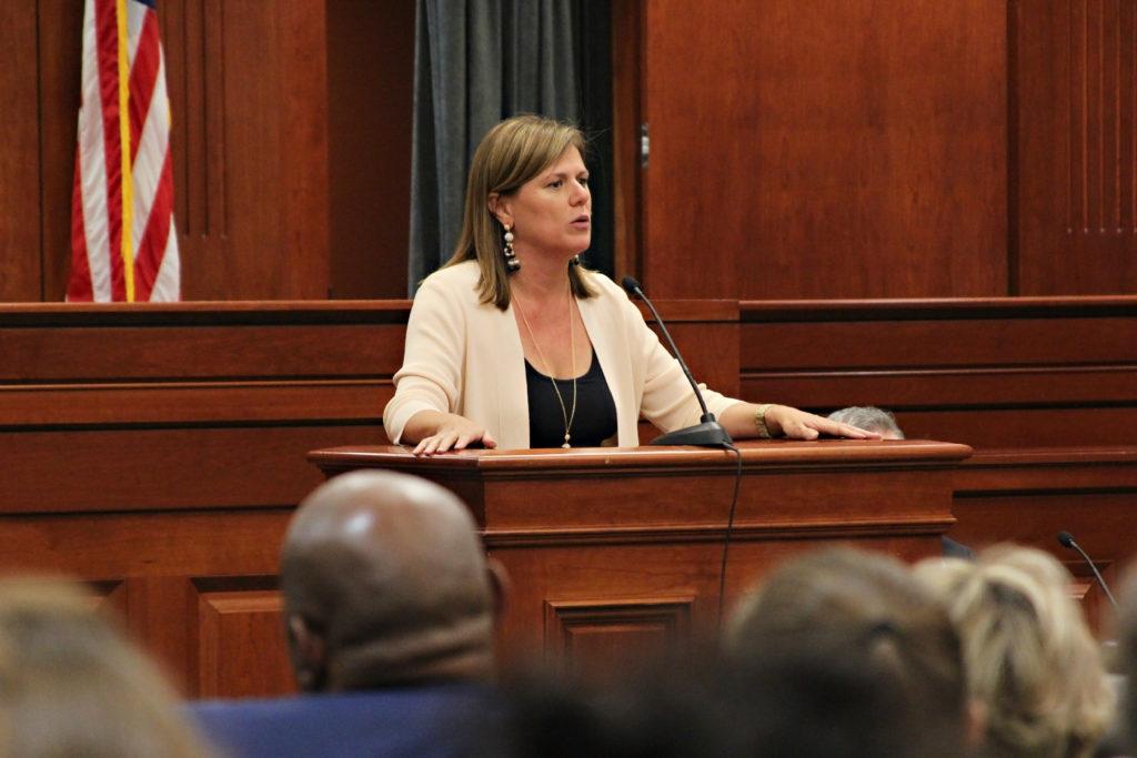 Patricia Cummings speaking at podium