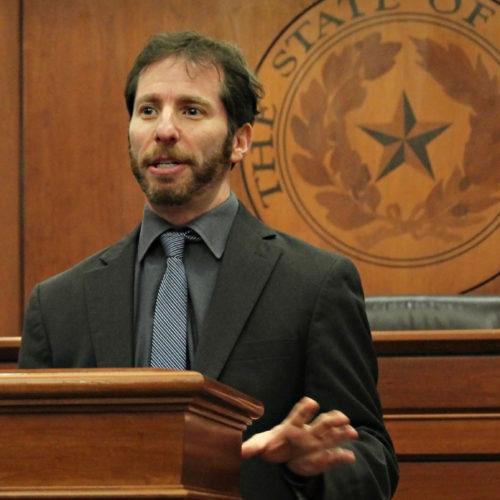 John Pollock standing at podium