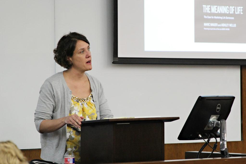 Ashley Nellis speaking at podium