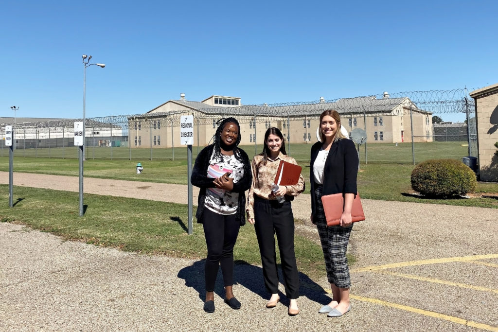 Students standing in front of TDCJ's Hobby Unit