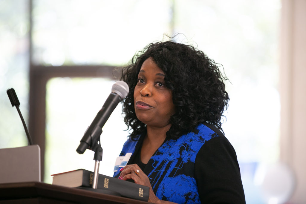 Photo of Audrey Selden speaking at podium