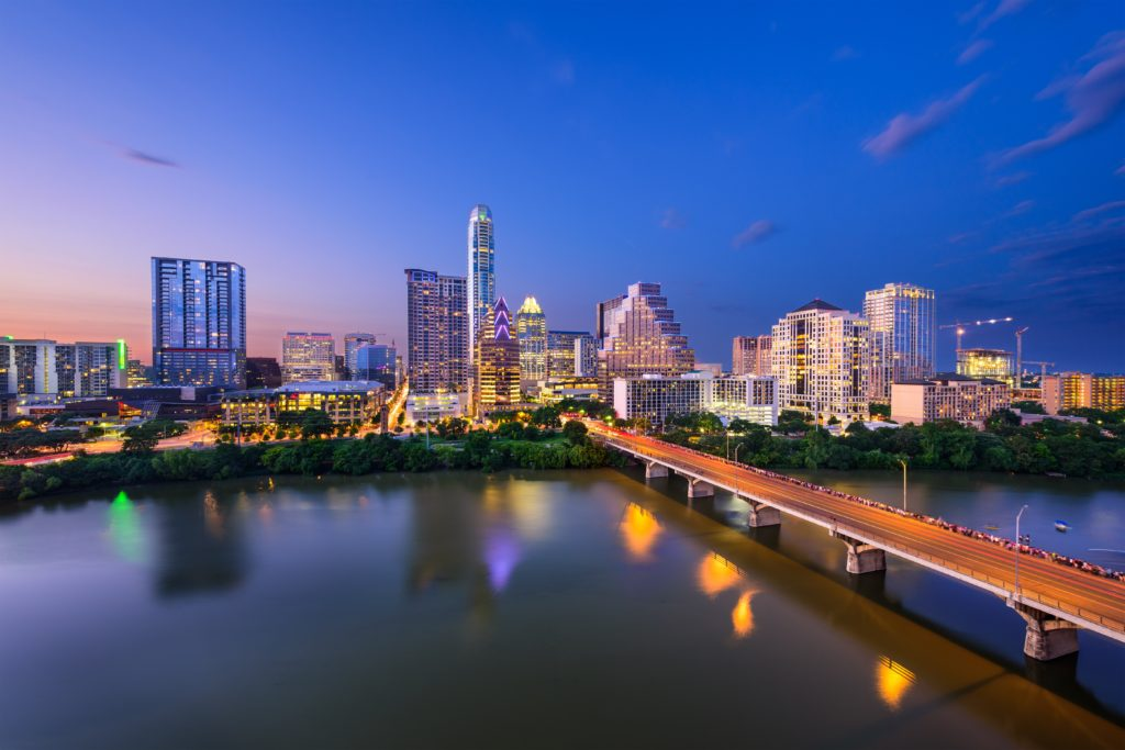 Downtown Austin, Texas at dusk, overlooking the Ann W. Richards Congress Avenue Bridge