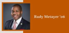Slide with a portrait of Rudy Metayer on top of a burnt orange background.