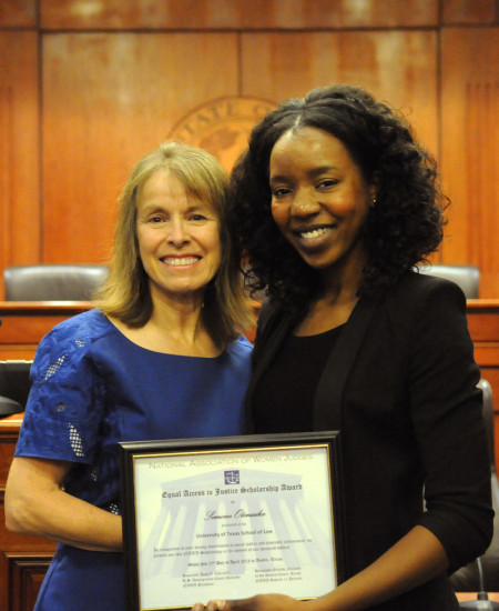 Judge Orlinda Naranjo, left, stands with Simone Otenaike, '15, winner of the National Association of Women Judges District 11 Access to Justice Scholarship, at the Color of Justice event at the Law School on April 17, 2013.