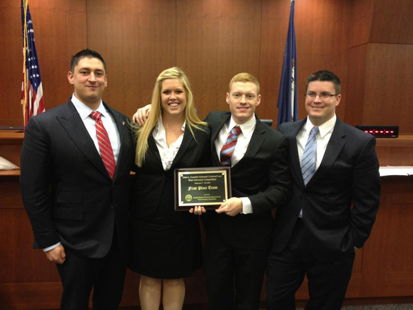 John L. Costello National Criminal Law Trial Advocacy Competition National Champions are, left tor right, Alex Hughes, Maryssa Simpson, Will Clark, and Brandan Montminy.