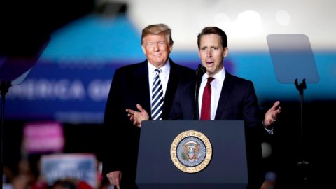 President Donald Trump listens then-Senate candidate Josh Hawley speaks at a rally in Columbia, Mo., on Nov. 1, 2018.Scott Olson / Getty Images file