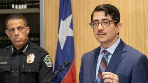 District Attorney Jose Garza speaking in front of a podium