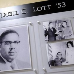 Three photos in wall plaque honoring Virgil C. Lott '53