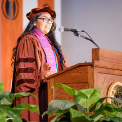 Jessica Cisneros, Texas Law Class of 2018, speaking at the 2018 Latinx Graduation