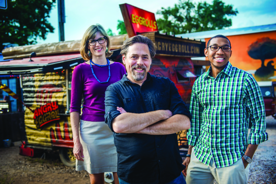 Clinical Professor Heather Way, food truck owner Stan Flukinger and alumnus Erik Combs, '14, stand outside Angry Egg Roll on South Congress.