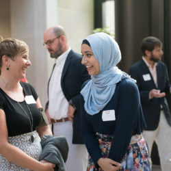 A mentor and mentee laughing together at the mentoring program Reception in 2017.