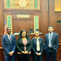 Michael Vance, Amber Magee, Marley Fraizer, and Linzy Scott standing in a court room