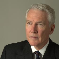 Portrait of Professor Philip Bobbitt set against a beige background.