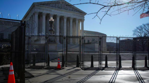 Barbed wire and security fencing surrounds the U.S. Supreme Court in Washington