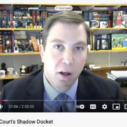 Screen image of Prof. Steve Vladeck talking to the camera while testifying on YouTube