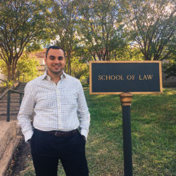 William Zakhary, pictured in front of the School of Law sign.