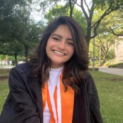 Portrait of Barbara Di Castro Pimenta wearing undergraduate graduation regalia.