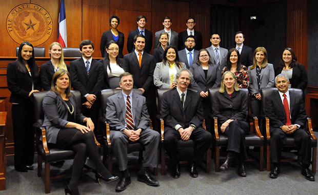 The 40th anniversary Criminal Defense Clinic class pictured with (seated from left to right): Supervising Attorney Patricia Cummings, Dean Ward Farnsworth, Clinic Director Bill Allison, Associate Dean Eden Harrington and Supervising Attorney Richard Segura Jr.