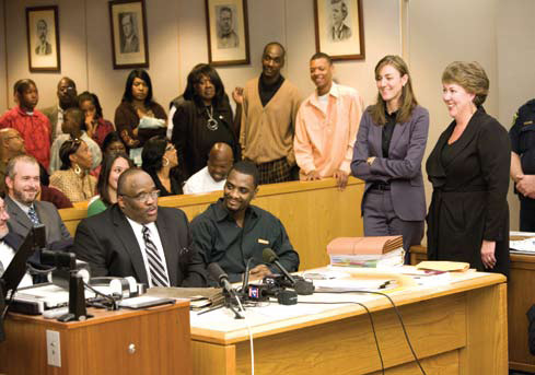 Claude Simmons, seated far left, and Christopher Scott, seated right, at their exoneration hearing in a Dallas courtroom on October 23, 2009.