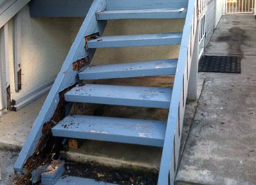 A deteriorating stairway at an Austin apartment complex.