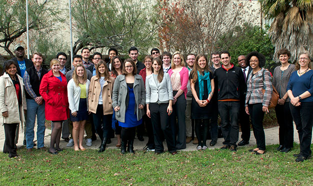 Students, staff, faculty and alumni who participated in the Pro Bono in January trip stand together for a group photo.