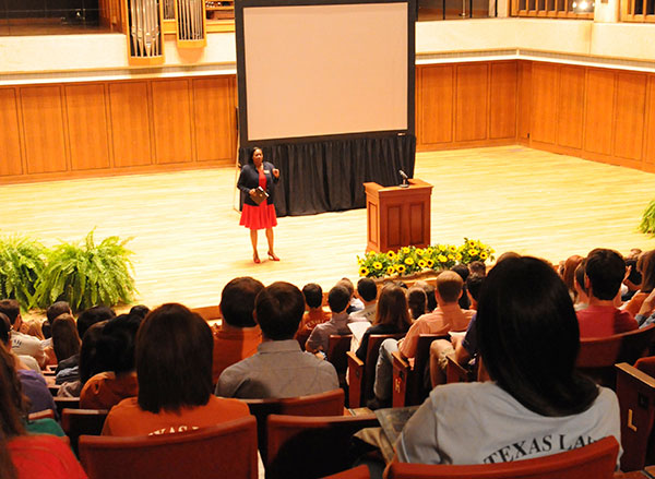 Lisa Tatum, president of the State Bar of Texas, led the students in taking the pledge during orientation.