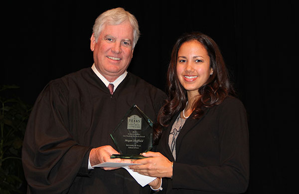 Megan Sheffield receives the award from Justice Paul Green of the Supreme Court of Texas.