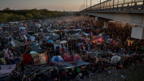 Immigrants under a Texas bridge