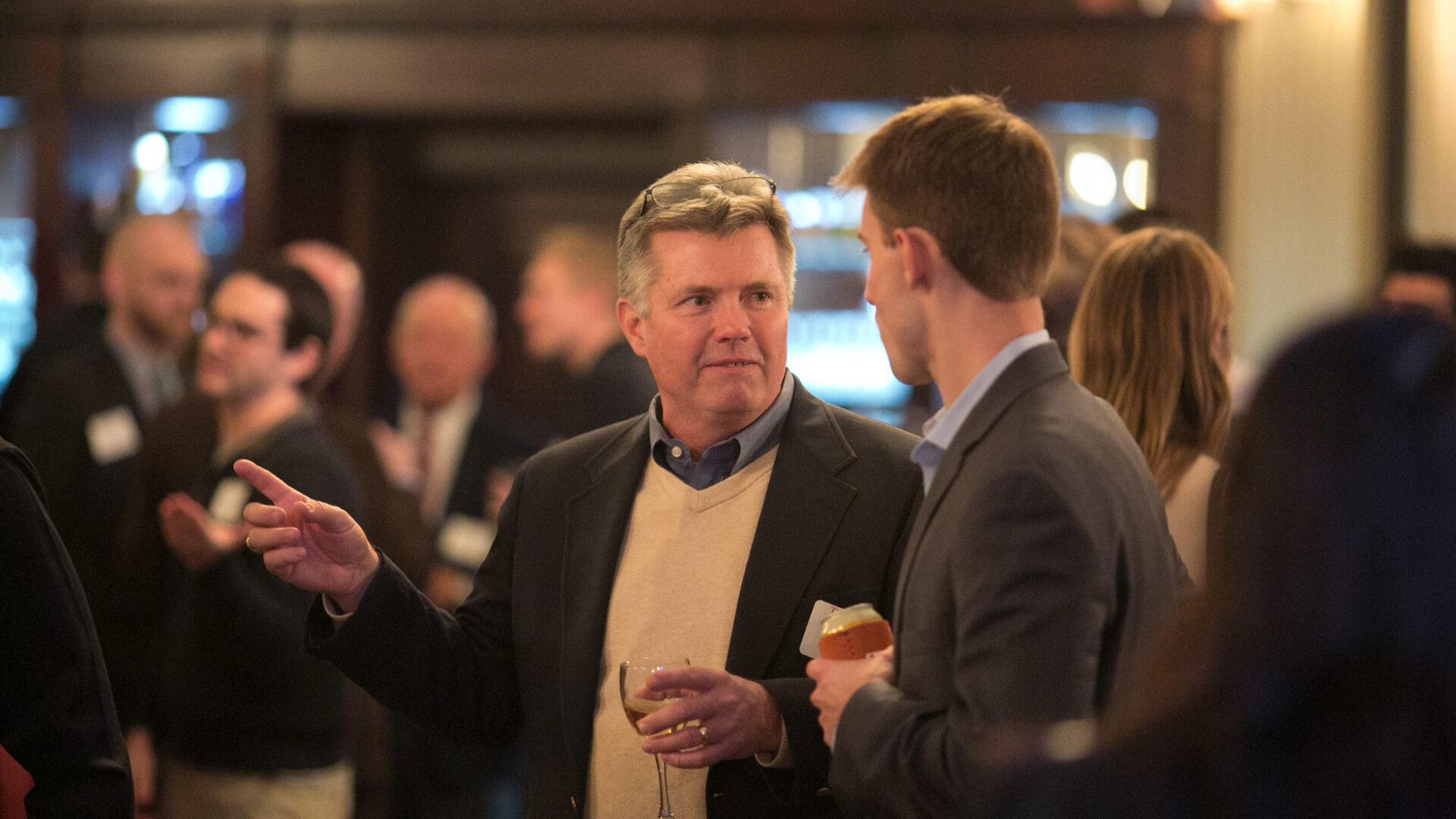 austin alumni association members chatting