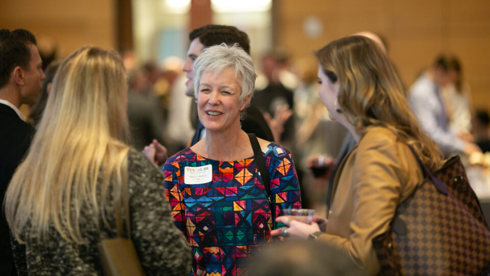 Women in a small group talking at a networking event. Click to learn How to Make a Gift to Texas Law.