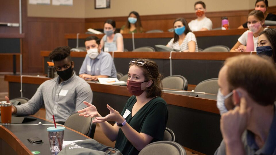 Students wear face masks in fall 2020 Texas Law classroom. Click to learn more about creating a named, endowed Scholarship or Loan Forgiveness fund.