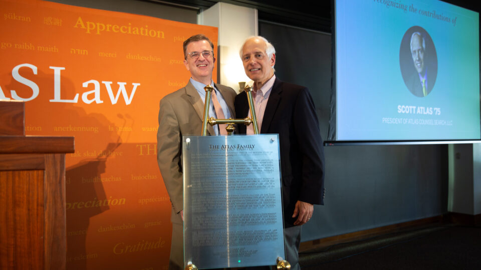 Dean Farnsworth and Scott Atlas stand behind a podium at the 2020 Scholarship Appreciation Luncheon. Click to learn about giving societies.