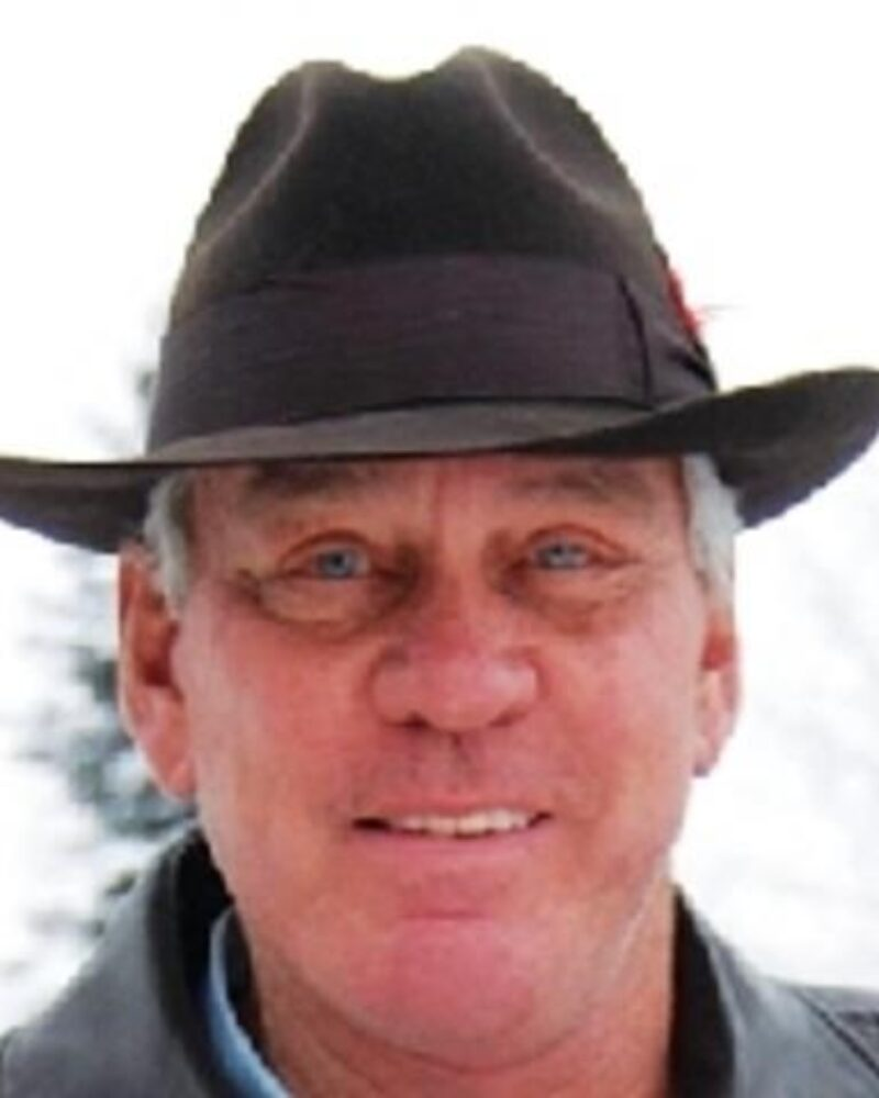 Portrait of Tom Thomas in a brown cowboy hat